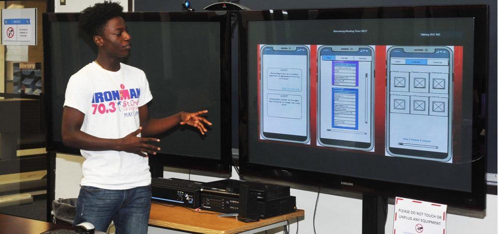 Photo of UVI student presenting at Hackfest