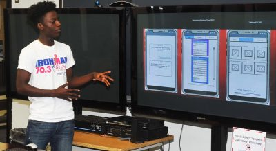 Photo of UVI student presenting at Hackfest